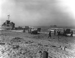 Landing scene on Red Beach at Gela, Sicily, 10 Jul 1943; note LCI(L)-220 at left, a LCM from USS Bellatrix, two LCVPs, and a jeep