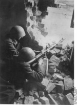 German Volkssturm troops with a MG 34 machine gun in a ruined building in Silesia, Germany (now Poland), Apr 1945