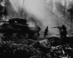 American troops advanced under the cover of M4 Sherman tank