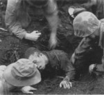 Japanese Army corporal Shigeto being dug out of his burrowed defensive position, Cape Gloucester, New Britain, Bismarck Archipelago, circa mid-Dec 1943