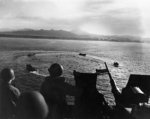 LCVP landing craft circling off Cape Torokina, Bougainville, Solomon Islands while awaiting orders, 1 Nov 1943; note 20mm Oerlikon AA gun; photographed from aboard APA-13 USS American Legion