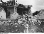Spanish civilian checking out a building destroyed in the Battle of Guadalajara, Spain, Mar 1937