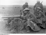 Spanish Nationalist field gun crew, the Battle of Guadalajara, Spain, Mar 1937, photo 1 of 2