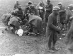 Spanish Nationalist troops treating a wounded comrade, Battle of Guadalajara, Spain, Mar 1937