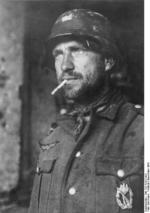 A German soldier in Stalingrad, Russia, Nov 1942; note silver badge on his chest