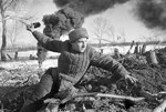 Soviet soldier throwing a grenade near Stalingrad, Russia, 1942