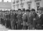 Men of the para-military Sudetendeutsche Freikorps lining up to greet Hitler who was scheduled to arrive shortly, Niemes, Sudetenland, Germany, 10 Oct 1938