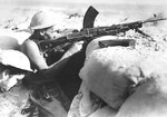 Australian troops in a foxhole with Bren gun near Tobruk, Libya, Aug 1941