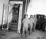 Three accused Japanese war criminal being led to their cells at the Supreme Court of Singapore, 21 Jan 1946