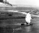 Japanese freighter at Truk, Caroline Islands hit by a torpedo dropped from a US Navy squadron VT-10 Avenger aircraft, 17 Feb 1944, photo 1 of 2