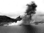 Smoke rising from the Japanese naval base at Dublon Island, Truk Atoll, Caroline Islands, 29-30 Apr 1944