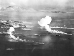 Japanese ships and fishing boats under attack at Dublon Island, Truk Atoll, Caroline Islands, 16 Feb 1944