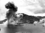 Japanese naval base, warships, and fishing boats at Dublon Island under American aerial attack, Truk Atoll, Caroline Islands, 16 Feb 1944, photo 2 of 2