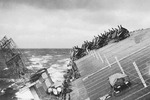 USS Cowpens rolling in heavy seas in Typhoon Cobra in the Pacific Ocean, 18 Dec 1944