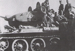 Soviet T-34 tank and crew during the Vistula-Oder Offensive, Poland or eastern Germany, Jan 1945