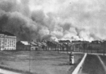Burning buildings in the Warsaw Ghetto, seen from Zoliborz district, Poland, late Apr 1943
