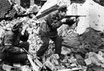 Polish resistance fighters Henryk Ozarek (with Vis pistol) and Tadeusz Przybyszewski (with Blyskawica submachine gun) fighting on Kredytowa-Krolewska Street, Warsaw, Poland, Oct 1944