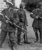 Polish resistance fighters Wojciech Omyla, Juliusz Bogdan Deczkowski, and Tadeusz Milewski in captured German uniforms and Kar98k rifles, Warsaw, Poland, 5 Aug 1944