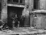 Polish fighters guarding entrance of their battalion headquarters, Warsaw, Poland, circa 24 Aug 1944