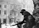 Polish resistance fighter near Krakowskie Przedmiescie Street, Warsaw, Poland, 23 Aug 1944; note captured German K98 rifle and helmet