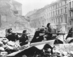 Polish resistance fighters with various small arms at the intersection of Swietokrzyska and Mazowiecka Streets, Warsaw, Poland, Aug 1944