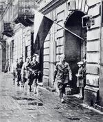 Polish insurgent fighter Lieutenant Stanislaw Jankowski and his men moments before W-hour (1700 hours) which marked the start of the Warsaw Uprising, Warsaw, Poland, 1 Aug 1944
