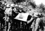 Chinese troops with a captured Japanese flag, Kunlun Pass, Guangxi, China, 31 Dec 1939