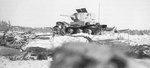 Destroyed Russian T-26 light tank, Finland, 13 Feb 1940