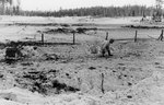 Finnish soldier dragging a box of ammunition on the eastern side of the Kollaa River, Russia, 17 Dec 1939