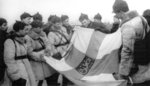 Soviet troops with a captured Finnish state flag, Finland, 1939-1940