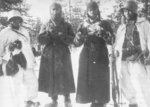 Finnish soldiers guarding two Soviet prisoners of war, Finland, 1939-1940