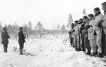 Finnish Army Lieutenant Aarne Juutilainen and his company holding a Christmas service near the Kollaa River, Finland, 24 Dec 1939