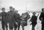 Finnish troops posing with the frozen corpse of a Soviet soldier, Finland, 1940