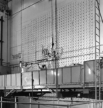 Workers loading uranium slugs into the X-10 Graphite Reactor