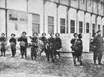 Workers carrying a gun manufactured at Jiangnan Arsenal, Shanghai, China, circa 1890