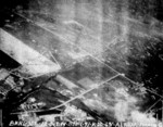 Matsuyama Airfield, Taihoku (now Taipei), Taiwan under attack by aircraft from USS Bunker Hill, 12 Oct 1944, photo 3 of 3