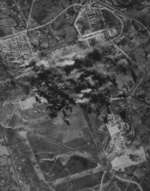 Shinchiku Airfield under B-29 attack, northern Taiwan, 17 Jan 1945, photo 3 of 3