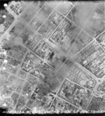 Taihoku General Government Building (near bottom of photograph) under aerial attack, Taihoku (now Taipei), Taiwan, 31 May 1945
