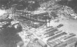 Aerial view of Yokosuka Naval Arsenal several days after the Great Kanto Earthquake of 1923, 3 or 4 Sep 1923; note battlecruiser Amagi in drydock