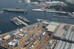 USS Kitty Hawk and other American warships at United States Fleet Activities Yokosuka naval base, Japan, 25 May 2006