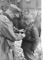 Hitler Youth member Willi Hübner being awarded the Iron Cross 2nd Class medal for bravery in combat, East Prussia, Germany, 9 Mar 1945