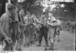 Members of Hitler Youth receiving rations at a camp near Potsdam, Germany, 1932