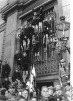 Hitler Youth members climbing window bars to observe May Day celebrations, Lustgarten, Berlin, Germany, 1 May 1935