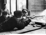 Hitler Youth members learning how to fire rifles, date unknown