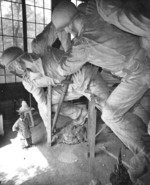 Sculptor Felix de Weldon working on the plaster model of the US Marine Corps War Memorial, circa 1954, photo 2 of 7