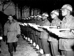 US Army Lieutenant General Joseph T. McNarney, Deputy Supreme Allied Commander in the Mediterranean Theater, inspecting African-American honor guard military policemen, Italy, 4 Jan 1945