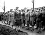 African-American US Army WAC Major Charity E. Adams and Captain Abbie N. Campbell inspecting WAC members of the 6888th Central Postal Directory Battalion, England, United Kingdom, 15 Feb 1945
