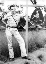 Jack Heyn posing next to a sign at the 13th Bomb Squadron of USAAF 3rd Bomb Group camp at Port Moresby, Australian Papua, early 1943