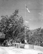 Flagpole by the orderly room at an airfield at Port Moresby, Australian Papua, 1943