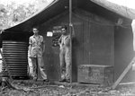 Photographers Marvin Culbreth and Jack Heyn of USAAF 3rd Bomb Group at the Dobodura Airfield photo shack, Australian Papua, mid-1943